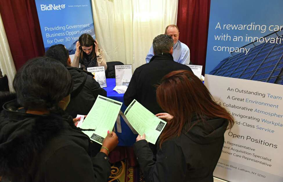 Job seekers stand in line to talk to representatives at the BidNet booth during the Times Union Job Fair at the Albany Marriott hotel on Monday Jan. 16, 2017 in Colonie, N.Y. (Lori Van Buren / Times Union)