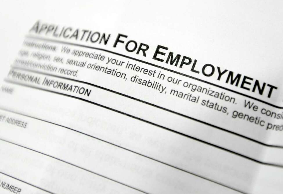 An employment application form on a table at a job fair in Hudson, N.Y.
