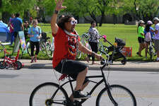 A cyclist rides past Mission Concepcion during the spring Siclovia Sunday. Streets from the downtown HEB store to the Mission were blocked off to all motorized traffic.