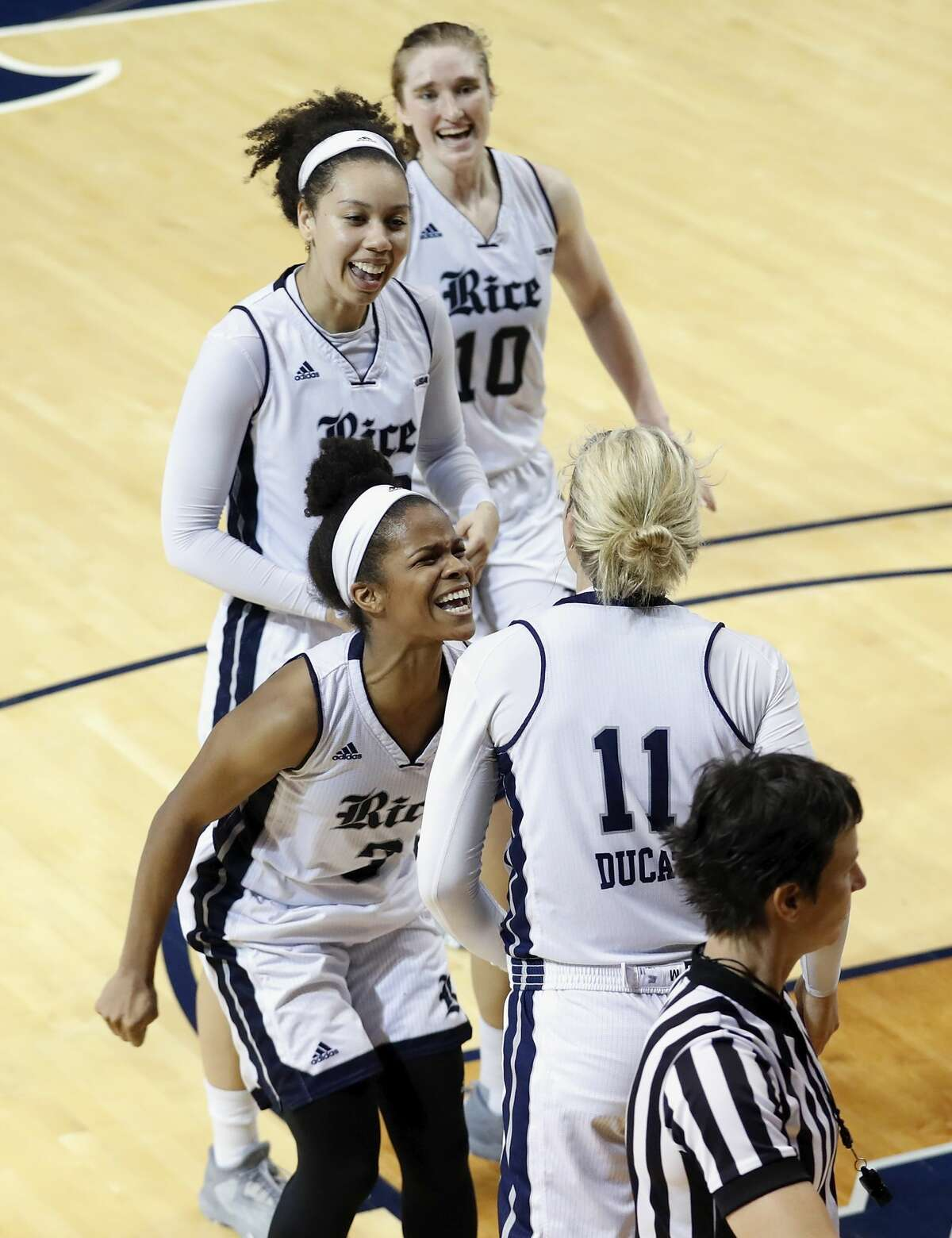 Rice Owls guard Maya Hawkins (3) celebrates with Rice Owls forward Lexie Ducat (11) after drawing a foul on a layup in the second half during the Women's Basketball Invitational Championship Game between the UNC-Greensboro Spartans and the Rice Owls at Tudor Field House in Houston, TX on Sunday, March 26, 2017.
