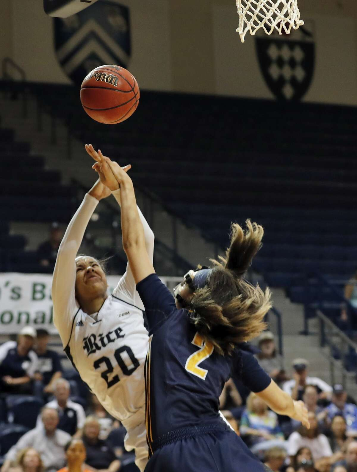 Rice Owls guard Shani Rainey (20) is fouled by North Carolina Greensboro Spartans guard Alexus Willey (2) in the second half during the Women's Basketball Invitational Championship Game between the UNC-Greensboro Spartans and the Rice Owls at Tudor Field House in Houston, TX on Sunday, March 26, 2017.