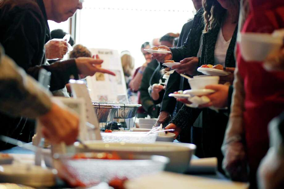 People make their way around the booths to try different food during the 14th Annual Jewish Food Festival sponsored by Price Chopper at Congregation Gates of Heaven on Sunday, March 26, 2017, in Schenectady, N.Y.    (Paul Buckowski / Times Union) Photo: PAUL BUCKOWSKI / 20039879A