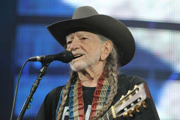 "Willie Nelson and his guitar ""Trigger"" perform before a sold-out concert at RodeoHouston Saturday, March 18, 2017, in Houston. ( Steve Gonzales  / Houston Chronicle )"