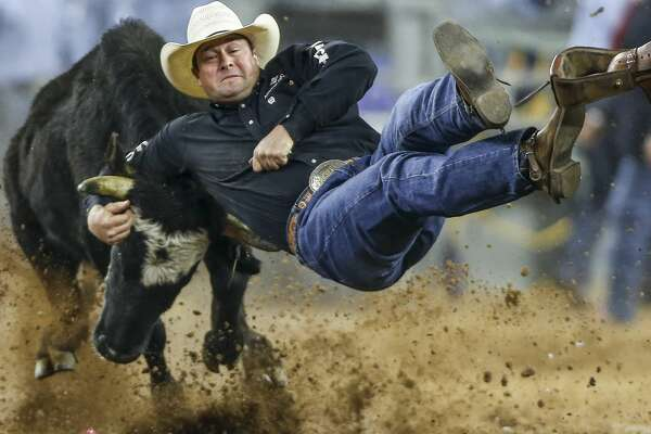 Steer wrestler Billy Bugging slips off his calf during round three of Super Series III at the Houston Livestock Show and Rodeo Wednesday, March 15, 2017 in Houston. ( Michael Ciaglo / Houston Chronicle )