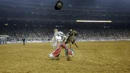 Tim O'Connell throws his hat into the air after a strong bareback ride during the Houston Rodeo on Sunday, March 26, 2017, in Houston. ( Elizabeth Conley / Houston Chronicle )