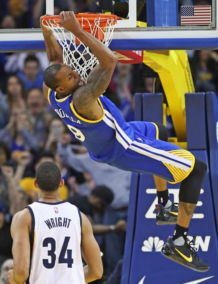 Golden State Warriors' Andre Iguodala celebrates his dunk in 4th quarter during Warriors' 106-94 win over Memphis Grizzlies in NBA game at Oracle Arena in Oakland, Calif., on Sunday, March 26, 2017. Photo: Scott Strazzante, The Chronicle