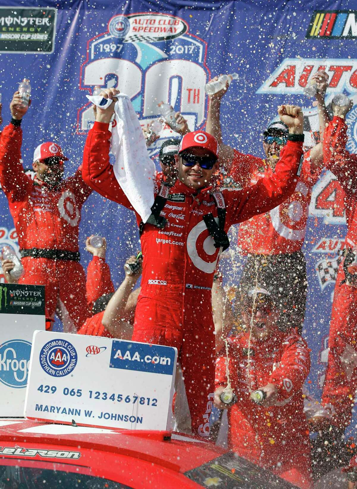 Kyle Larson celebrates after winning the NASCAR Cup Series auto race at Auto Club Speedway in Fontana, Calif., Sunday, March 26, 2017. (AP Photo/Alex Gallardo) ORG XMIT: CAAG110