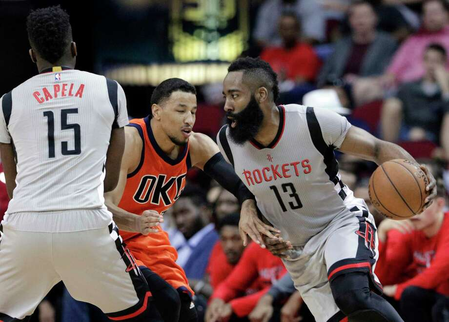 Houston Rockets' Clint Capela (15) blocks Oklahoma City Thunder's Andre Roberson as James Harden (13) drives around them during the second half of an NBA basketball game in Houston, Sunday, March 26, 2017. (AP Photo/Michael Wyke) Photo: Michael Wyke, FRE / FR33763 AP