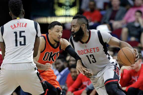 Houston Rockets' Clint Capela (15) blocks Oklahoma City Thunder's Andre Roberson as James Harden (13) drives around them during the second half of an NBA basketball game in Houston, Sunday, March 26, 2017. (AP Photo/Michael Wyke)