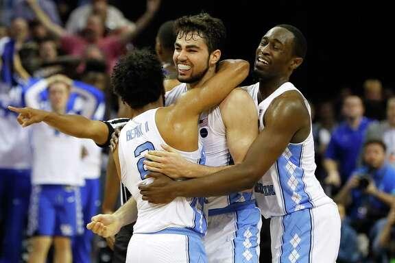 North Carolina's Luke Maye (center) celebrates with teammates after making the game- winning basket.