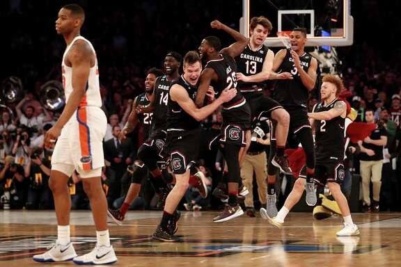 Maik Kotsar (21) and Justin McKie (20) of South Carolina celebrate with their teammates after defeating the Florida Gators on Sunday at Madison Square Garden.