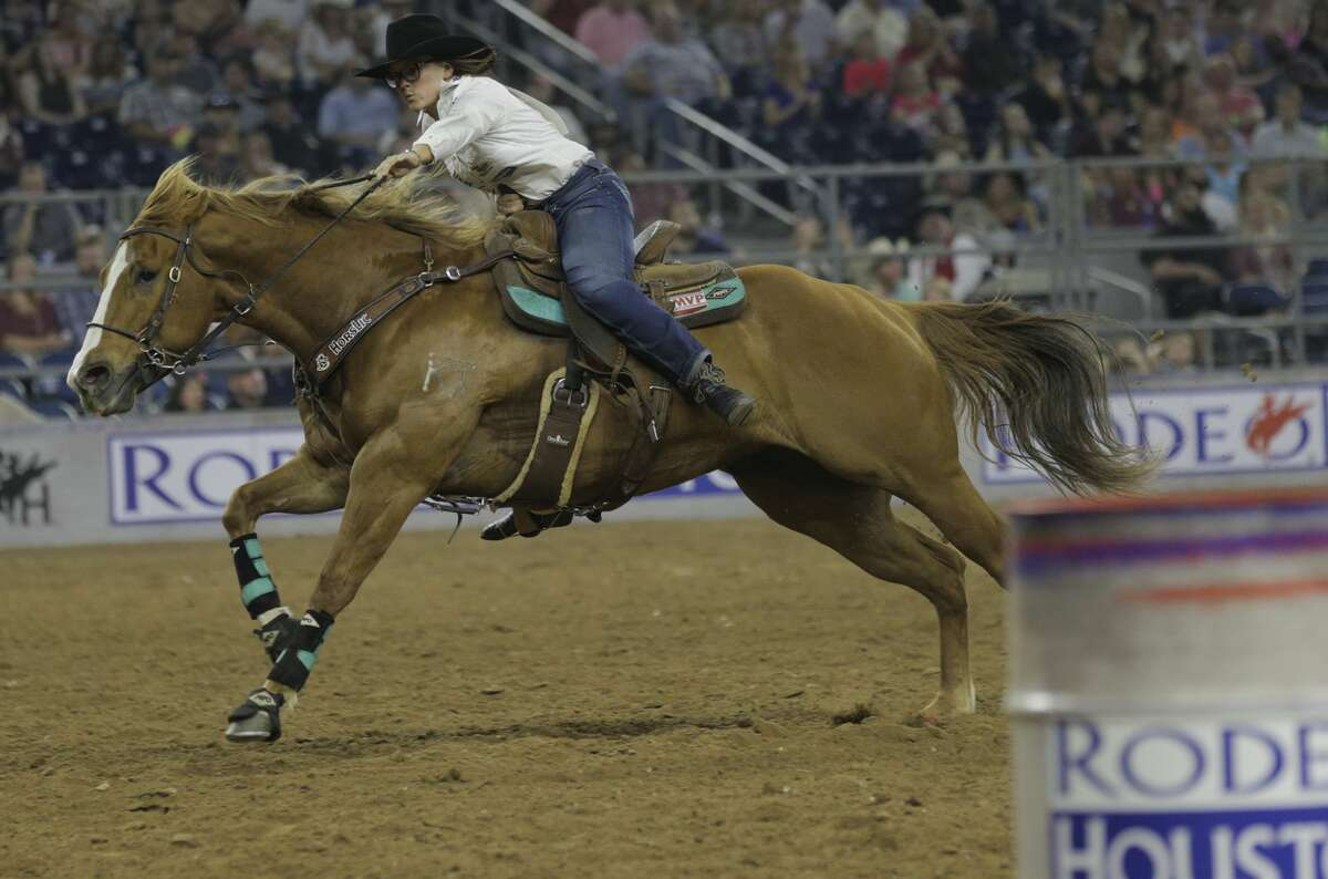 Ivy Conrado wins the barrel racing event, despite losing a stirrup at the Houston Rodeo on Sunday, March 26, 2017, in Houston. Along with winning the event, Conrado took home $25,000.( Elizabeth Conley / Houston Chronicle )