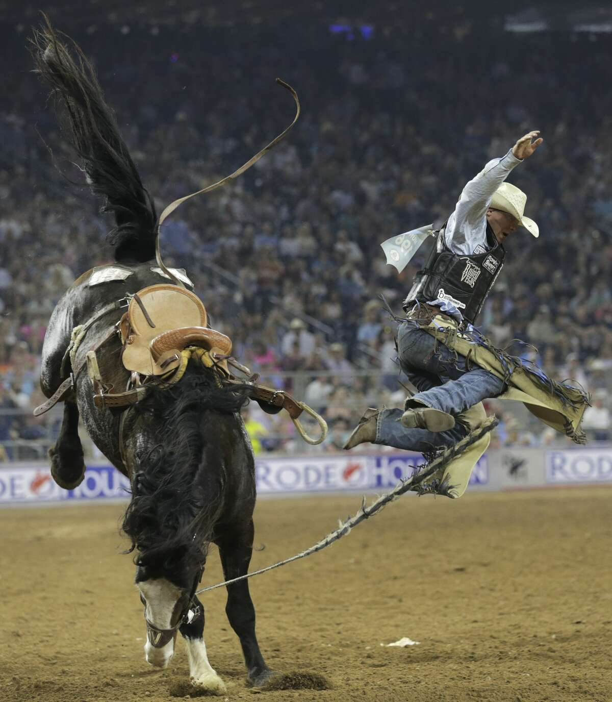 Tim O'Connell jumps off his horse after competing in the bareback riding event at the Houston Rodeo on Sunday, March 26, 2017, in Houston. O'Connell won the event and $25,000.( Elizabeth Conley / Houston Chronicle )