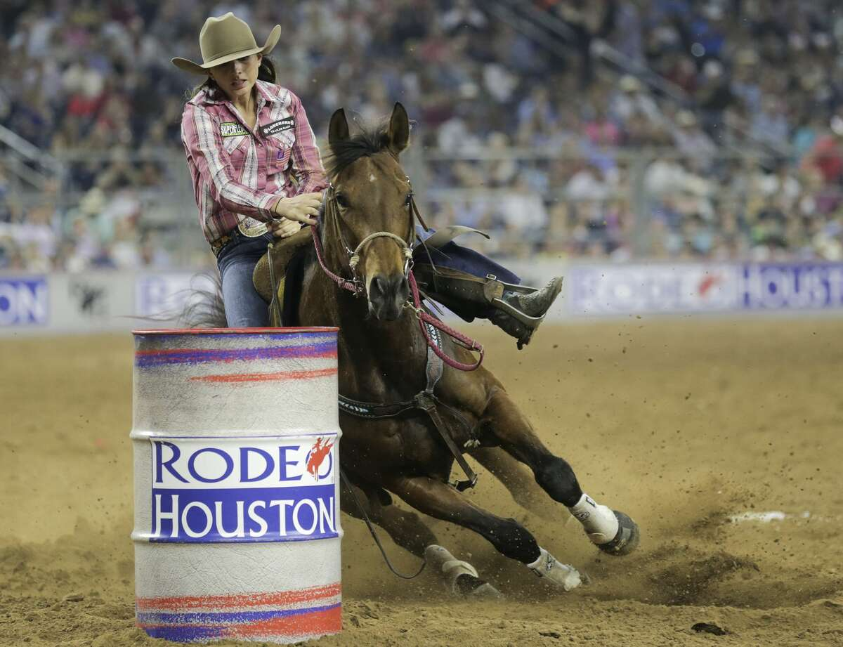 Abby Penson curves around a barrel during the barrel racing event, despite losing a stirrup at the Houston Rodeo on Sunday, March 26, 2017, in Houston. Benson came in third place. ( Elizabeth Conley / Houston Chronicle )