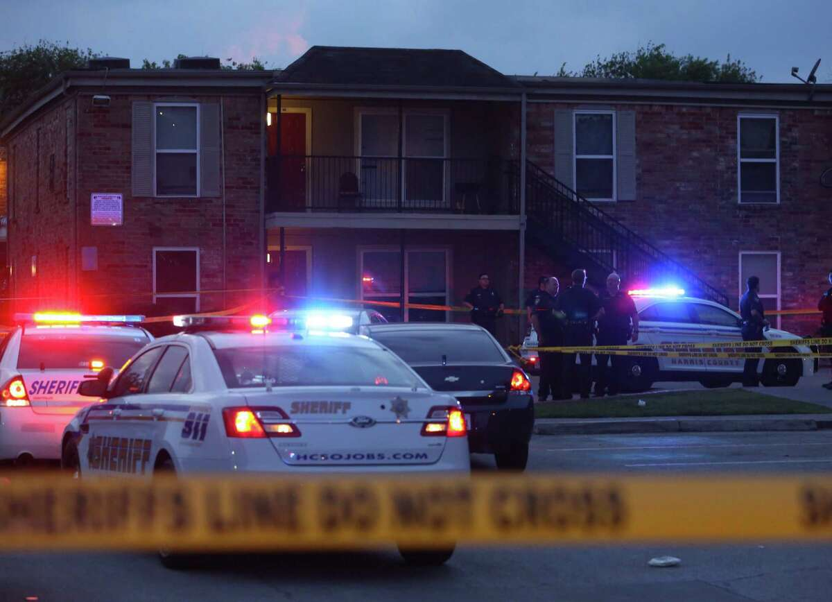 Harris County Sheriff's Office deputies investigate a fatal shooting scene at an apartment complex at 5600 block of Aldine Bender Road Sunday, March 26, in Houston. One male dead and five other victims were transported to different hospitals.