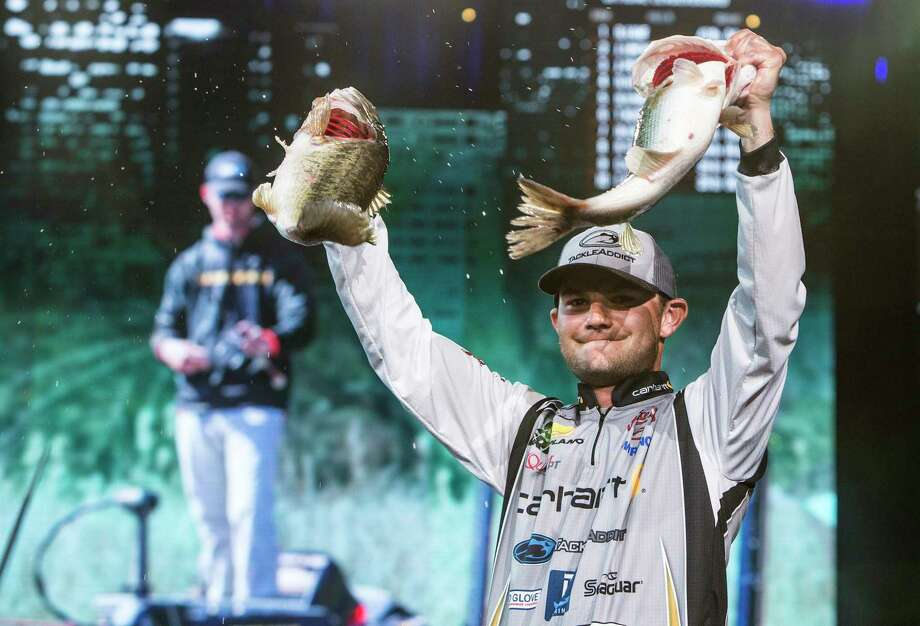 Bassmasters Classic winner Jordan Lee holds up two of the five fish he caught Sunday at Lake Conroe - a stringer that weighed in at 27 pounds, 4 ounces and lifted him to a 1-pound, 9-ounce win over Steve Kennedy. Photo: Brett Coomer, Staff / © 2017 Houston Chronicle
