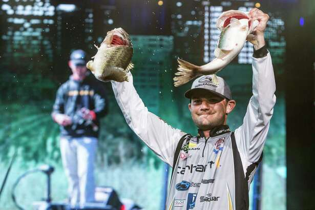 Bassmasters Classic winner Jordan Lee holds up two of the five fish he caught Sunday at Lake Conroe - a stringer that weighed in at 27 pounds, 4 ounces and lifted him to a 1-pound, 9-ounce win over Steve Kennedy.