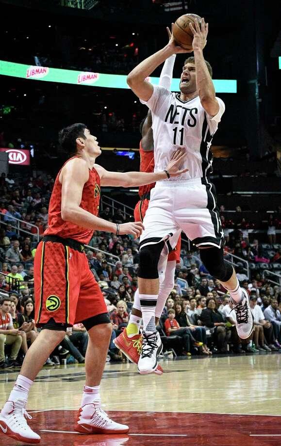 Brooklyn Nets center Brook Lopez (11) pulls up to shoot as Atlanta Hawks forward Ersan Ilyasova, of Turkey, defends during the first half of an NBA basketball game, Sunday, March 26, 2017, in Atlanta. Brooklyn won 107-92. (AP Photo/John Amis) ORG XMIT: GAJA115 Photo: John Amis / FR69715 AP
