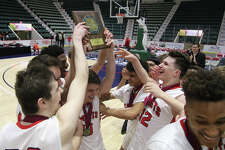 Albany Academy celebrates their win over Walton High School during the Class A Federation basketball final at the Glens Falls Civic Center Sunday, March 26, 2017. (Ed Burke-Special to The Times Union)