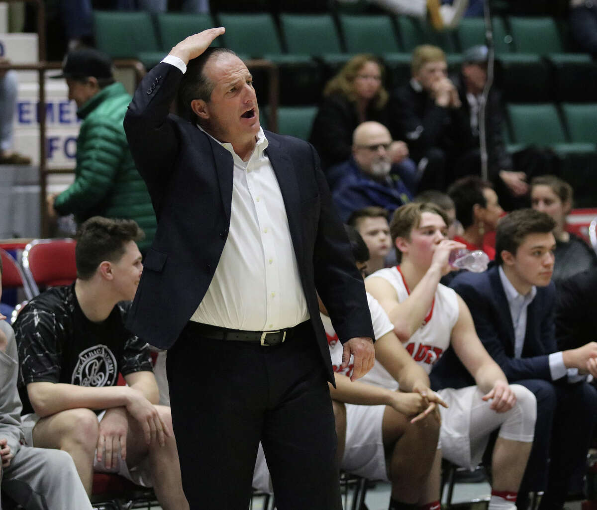 Albany Academy head coach Brian Fruscio signals his players during the Class A Federation basketball final against Walton High School at the Glens Falls Civic Center Sunday, March 26, 2017. (Ed Burke-Special to The Times Union)