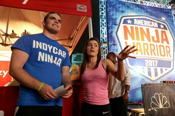 American Ninja Warrior San Antonio competitors Indy Car racing's Conor Daly (left) talks with Kacy Catanzaro before they run the course Sunday March 26, 2017.