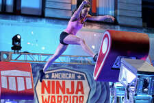 American Ninja Warrior San Antonio competitor Kacy Catanzaro runs the course.