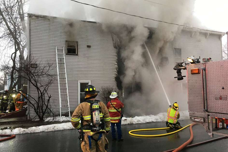 Firefighters are on the scene of a blaze that damaging a home on Washington Avenue, Waterford. The fire was reported at about 8:30 a.m. and smoke was still billowing from windows.