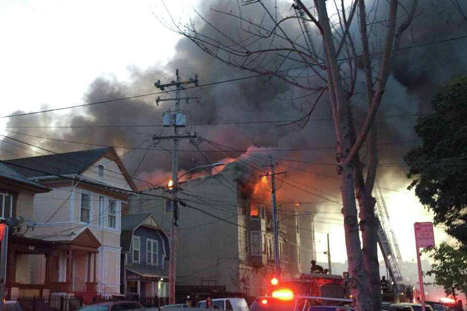 A fire was burning out of control Monday at an apartment building at Mead Avenue and Market Street in West Oakland.