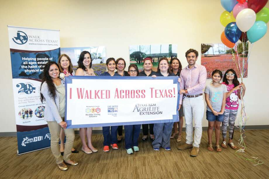 Team members from the Lone Star Family Health Center pose for a photo on June 28, 2016, after competing in the Walk Across Texas Community Challenge. Photo: Michael Minasi, Photographer / Conroe Courier
