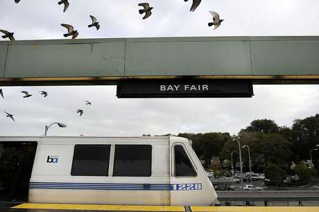 Birds fly above a train as it waits on the platform at the Bay Fair BART station in San Leandro, CA, on Thursday, December 18, 2014. Photo: Michael Short / Special To The Chronicle