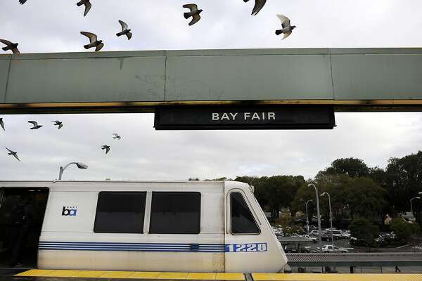 Birds fly above a train as it waits on the platform at the Bay Fair BART station in San Leandro, CA, on Thursday, December 18, 2014.