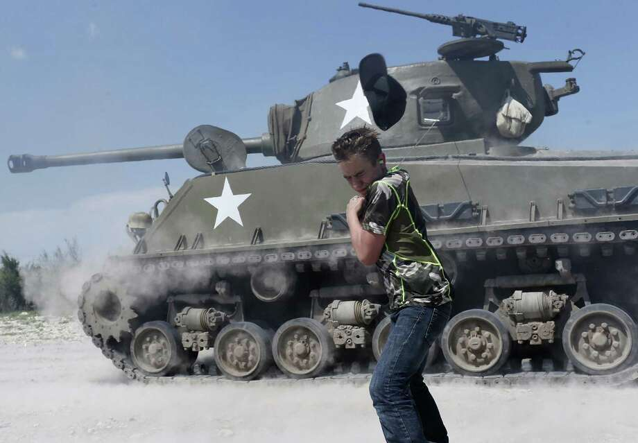 Carson Rogers of San Antonio shoots a 75 mm round from a Sherman tank at Drive Tanks northwest of Uvalde. Photo: Photos By Jerry Lara /San Antonio Express-News / © 2017 San Antonio Express-News