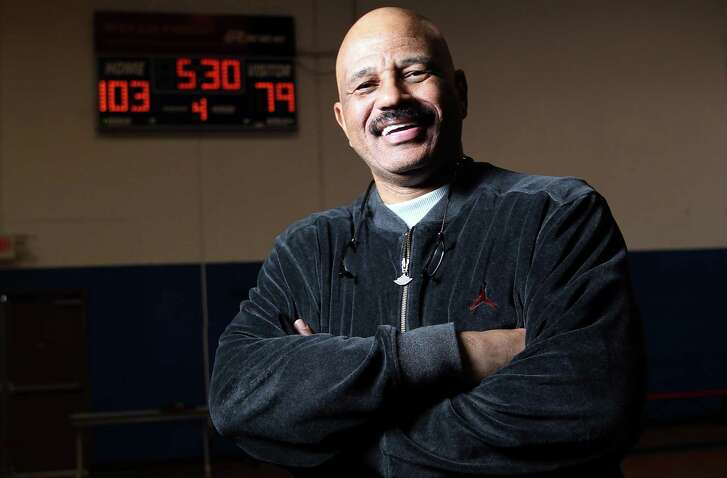 John Lucas, a former Spurs player and coach, works with young basketball players in Houston.