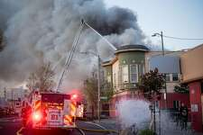 Firefighters battle an apartment building fire on San Pablo Ave. on Monday, March 27, 2017, in Oakland, Calif.
