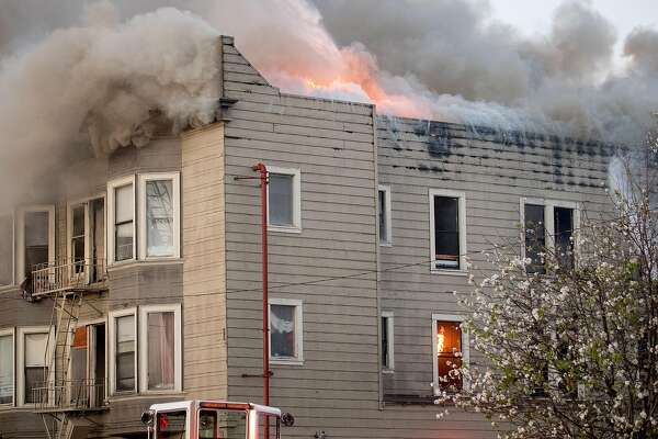 Flames rise from a residential building on San Pablo Ave. on Monday, March 27, 2017, in Oakland, Calif.