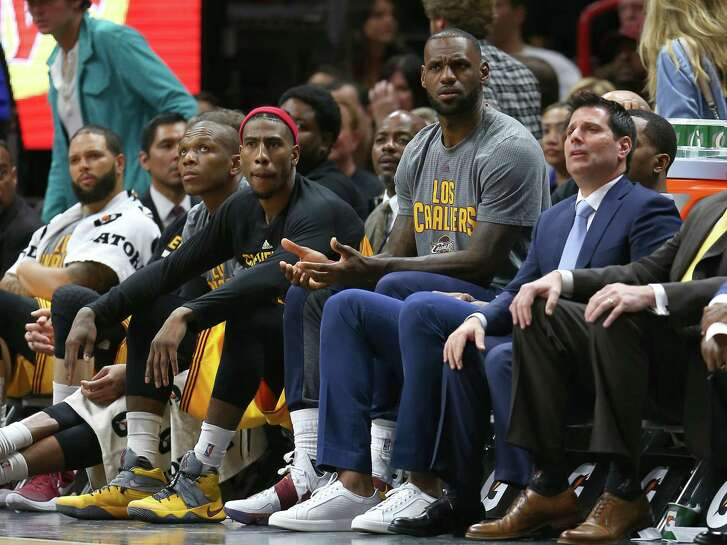 Cleveland Cavaliers star LeBron James watches from the bench during the third quarter against the Heat at American Airlines Arena on March 4, 2017 in Miami.