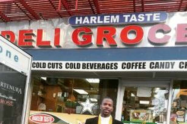 Troy Kitchen owner Cory Nelson outside the Blue Line Deli & Grocery, a Harlem spot also known as Hajji's that is credited with popularizing the chopped-cheese sandwich. (Photo courtesy Cory Nelson.)