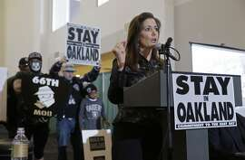 Oakland Mayor Libby Schaaf gestures during a rally to keep the Oakland Raiders from moving Saturday, March 25, 2017, in Oakland, Calif. NFL owners are expected to vote on the team's possible relocation to Las Vegas Monday or Tuesday at their meeting in Phoenix. (AP Photo/Eric Risberg)