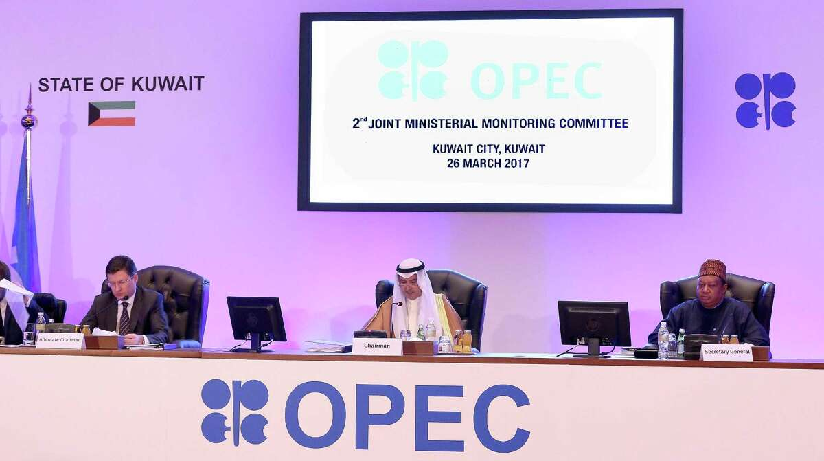 Russia's energy minister, Alexander Novak (from left); Kuwait's oil minister, Essam al-Marzouq; and OPEC's secretary general, Mohammad Sanusi Barkindo, attend Sunday's meeting for the 2nd Joint Ministerial Monitoring Committee of OPEC in Kuwait City.
