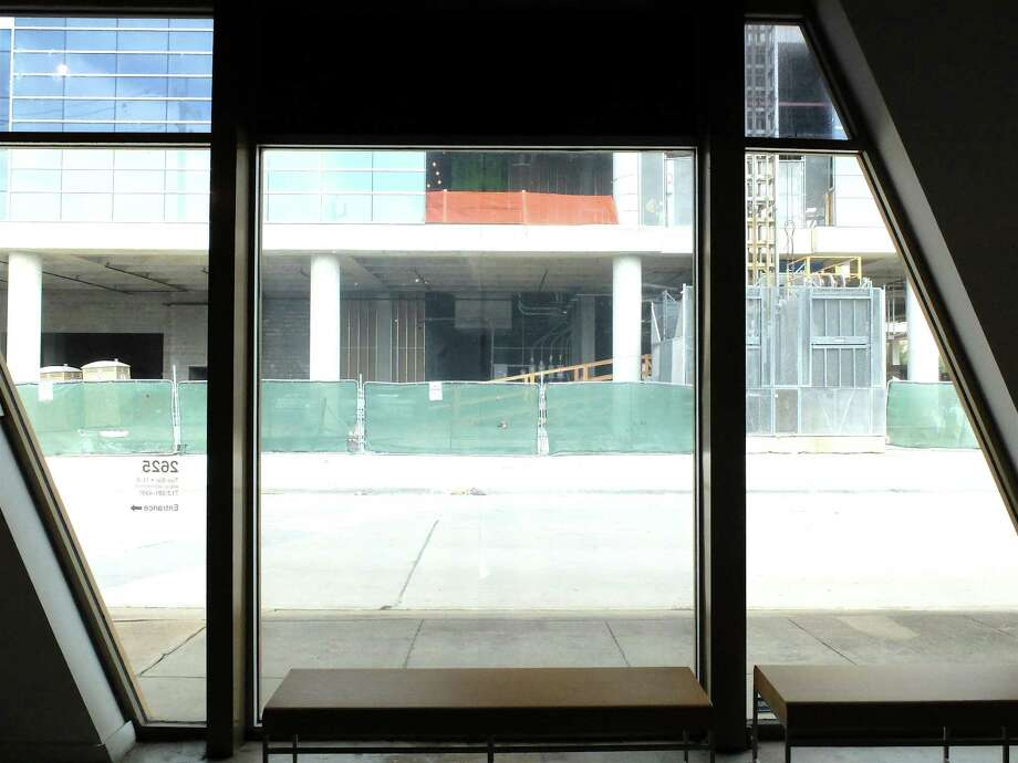 A view of construction of the mixed-use development Kirby Collection from the window of Nicole Longnecker Gallery on Colquitt Street. Photo: Molly Glentzer, Houston Chronicle