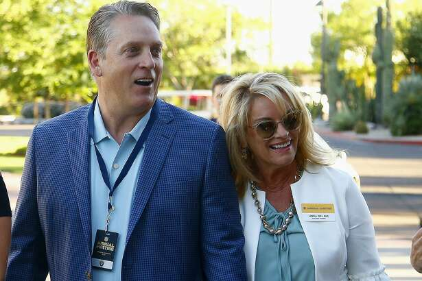 Oakland Raiders coach Jack Del Rio, left, and Linda Del Rio arrive for the start of the NFL football annual meetings Sunday, March 26, 2017, in Phoenix. (AP Photo/Ross D. Franklin)