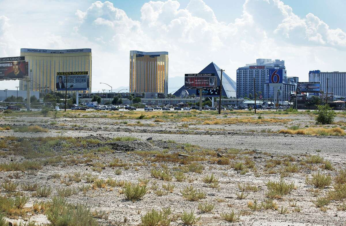 FILE - In this July 1, 2016, file photo, a vacant lot that is the site of a proposed football stadium sits near McCarran International Airport in Las Vegas. NFL owners approved the Oakland Raiders' move to Las Vegas on Monday morning, March 27, 2017, at the league meetings.