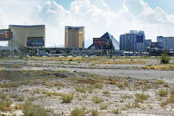 FILE - In this July 1, 2016, file photo, a vacant lot that is the site of a proposed football stadium sits near McCarran International Airport in Las Vegas. NFL owners approved the Oakland Raiders� move to Las Vegas on Monday morning, March 27, 2017, at the league meetings. (AP Photo/John Locher, File)