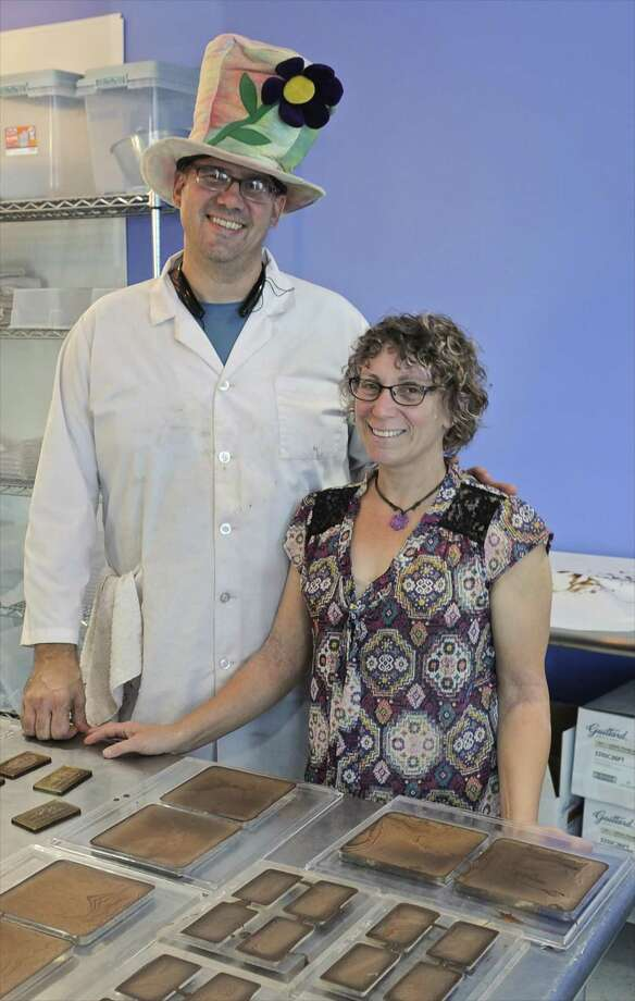 Jennifer and Michael Sauvageau owners of Noteworthy Chocolates, in Bethel, Conn. The unique business uses a laser to carve a message in premium chocolate. Tuesday, October 18, 2016. Photo: H John Voorhees III / Hearst Connecticut Media / The News-Times