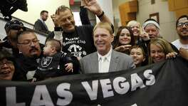 Oakland Raiders owner Mark Davis (center) meets with Raiders fans after speaking at a meeting of the Southern Nevada Tourism Infrastructure Committee in Las Vegas on April 28, 2016. NFL owners approved the Raiders move to Las Vegas on March 27, 2017, at the league meetings.