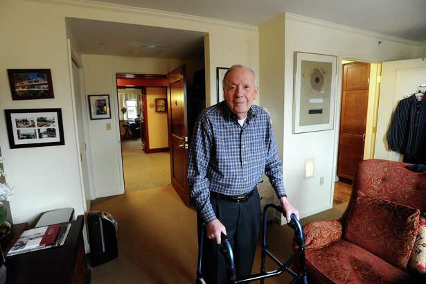 Carrol Houser, 87, poses inside his private room at the Edgehill Retirement Community in Stamford, Conn. on Tuesday, March 21, 2017.