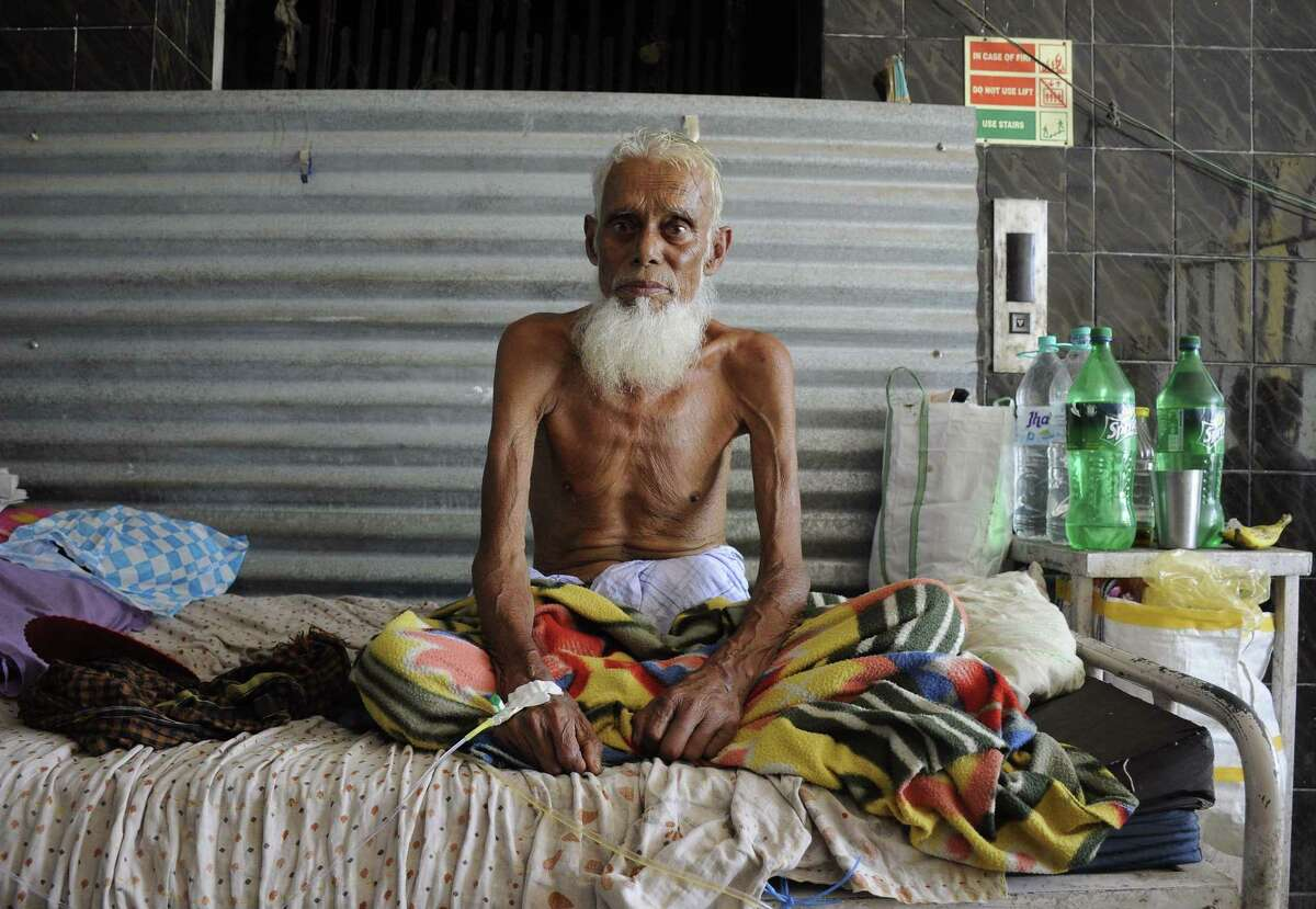 An Indian tubercolosis patient sits in a bed at a government hospital in Agartala on March 24 on World Tubercolosis Day.