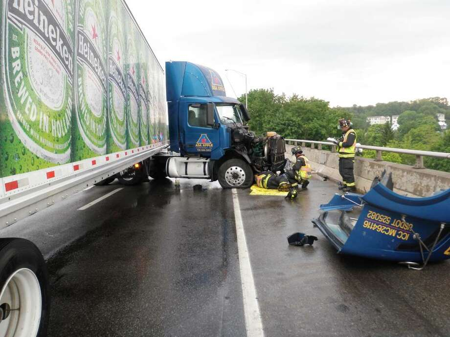 Westport firefighters responded at approximately 6 p.m. Tuesday, June 1, 2010, to the southbound side of the Saugatuck River bridge on I-95 after a tractor trailer jack-knifed. Photo: Contributed Photo / Westport News