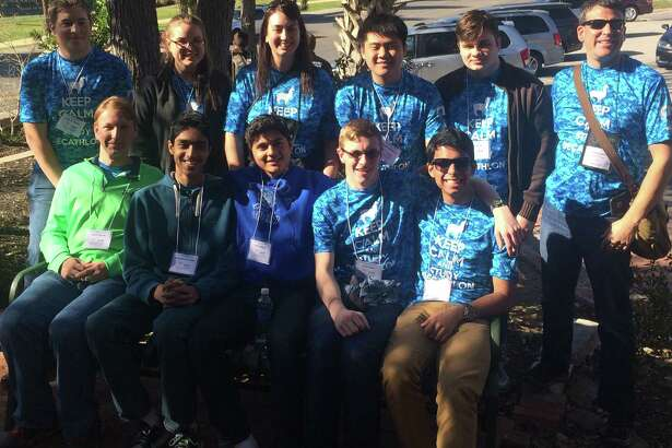 The Taylor High School Academic Decathlon team with its coaches, from left, back row:  Andrew Hewitt, Stephanie Yip Choy, Jennifer Brunsell, coach; Scott Lin, Kelly Kinsey and Eric Brunsell, coach; front row: Luke Holbrook, Achutha Srinivasan, Aziz Siddiqui, Will Scales and Oishik Saha.