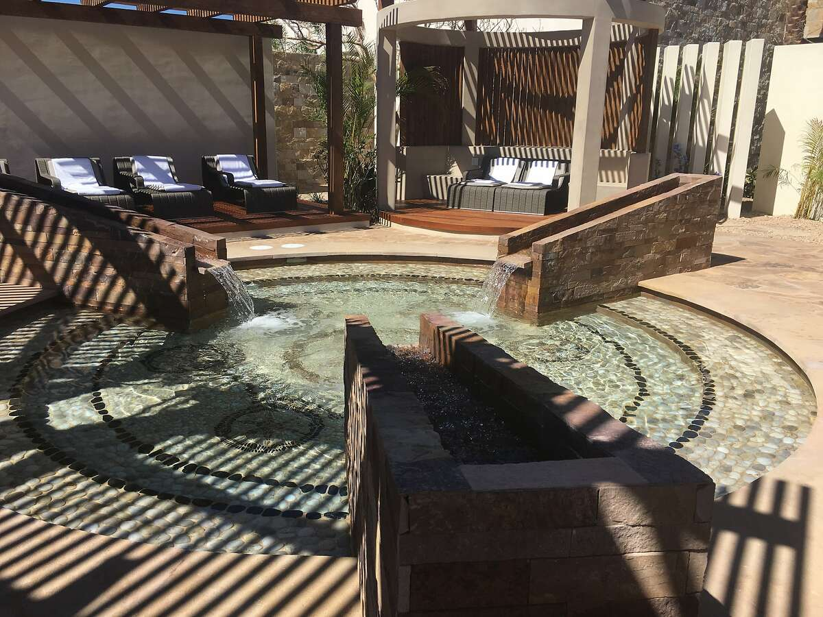 The spa at the new Chileno Bay Resort and Residences includes a water ritual that starts in a steam room and ends at this fountain-fed reflexology pool.